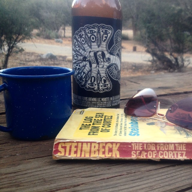 All a girl needs in the woods – Steinbeck and a bottle of 3Fs she overlooked in the cellar. #JinxProof #oldbutgood #EdRicketts #ReyesCreek