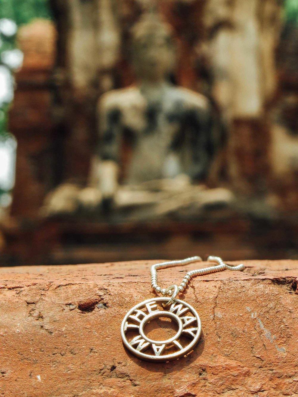 Infinity pendant  and Buddha