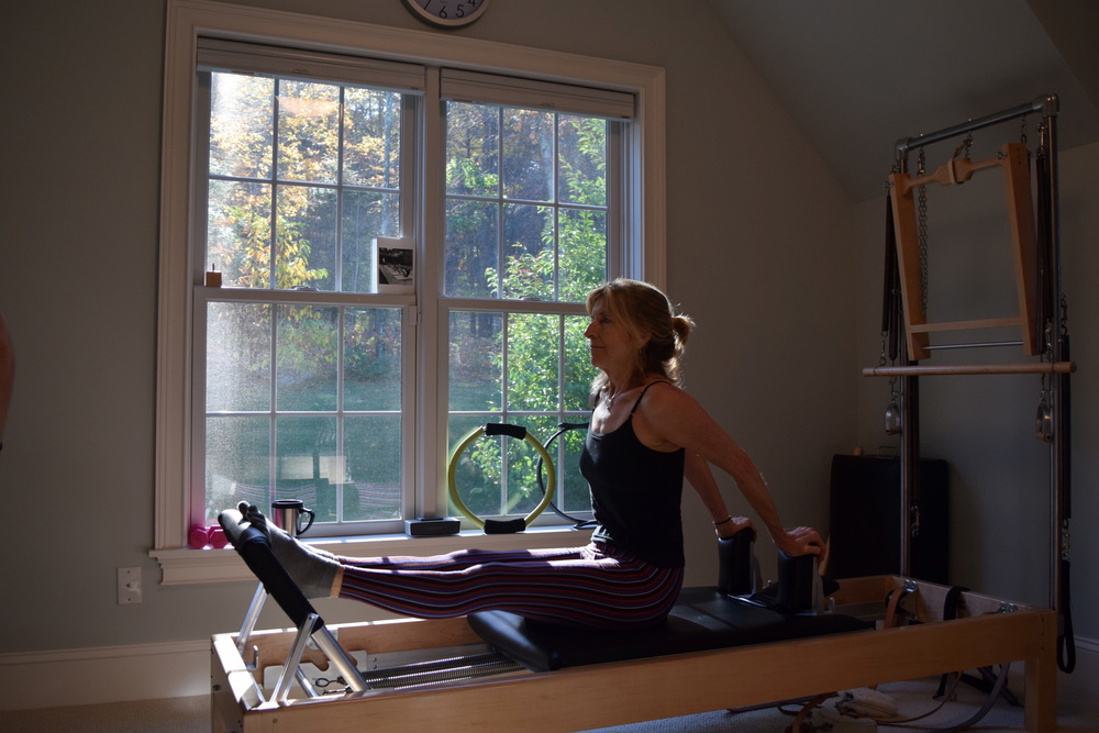 Leslie, a Pilates student from Unionville, CT, starting the day off right.