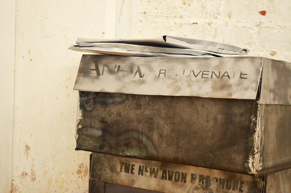 Replicas of Avon merchandise packaging found in the home of artist's grandmother. Forged and welded sheet steel and steel wire.
