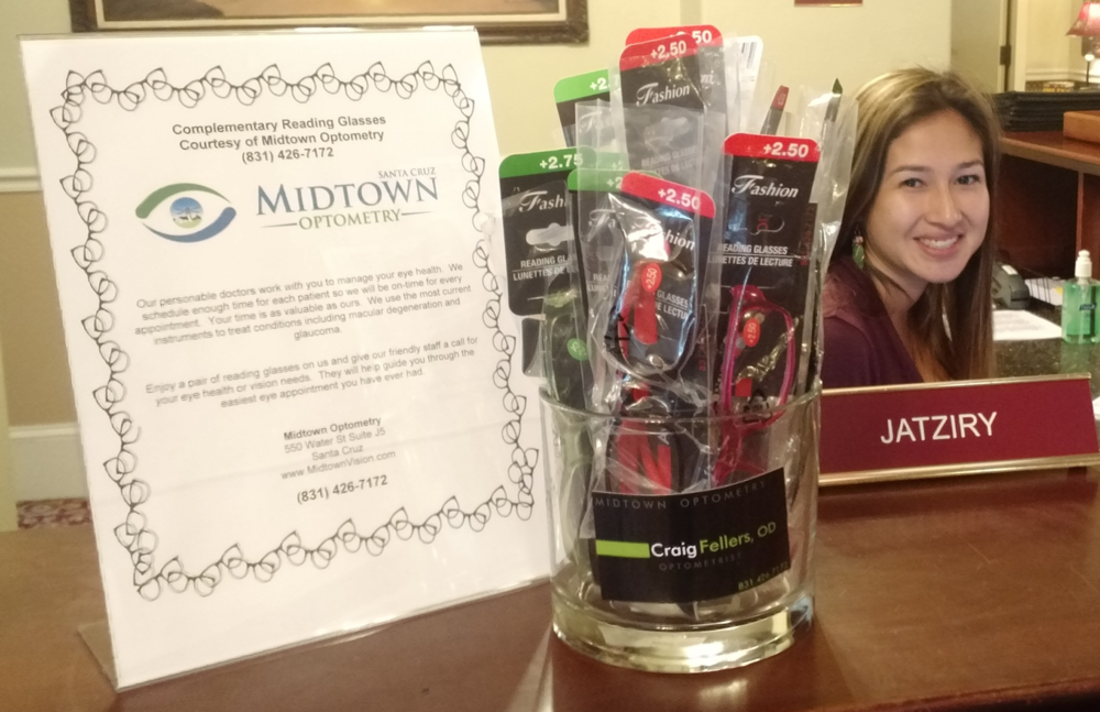 Jatziry helps distribute our free reading glasses to residents in need