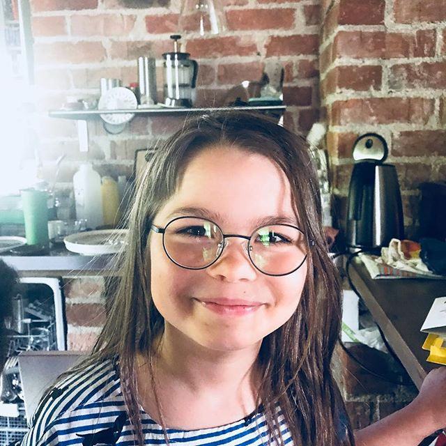 smiling girl wearing glasses