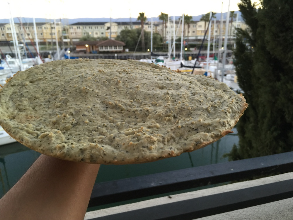 "Every low-carb pizza crust out there crumbles and doesn't behave like a pizza. Here is our 13"" crust doing a balancing act!"