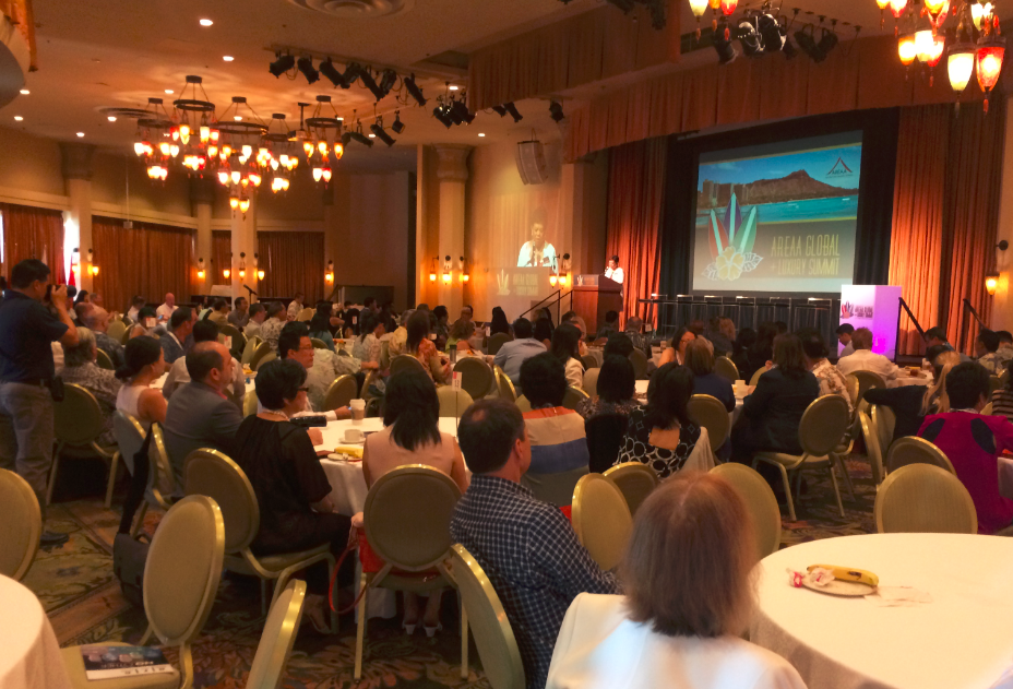 Above: Hundreds crowd the Monarch Room at the Royal Hawaiian Hotel in Honolulu to listen to global experts on the influence of foreign investment in the U.S.