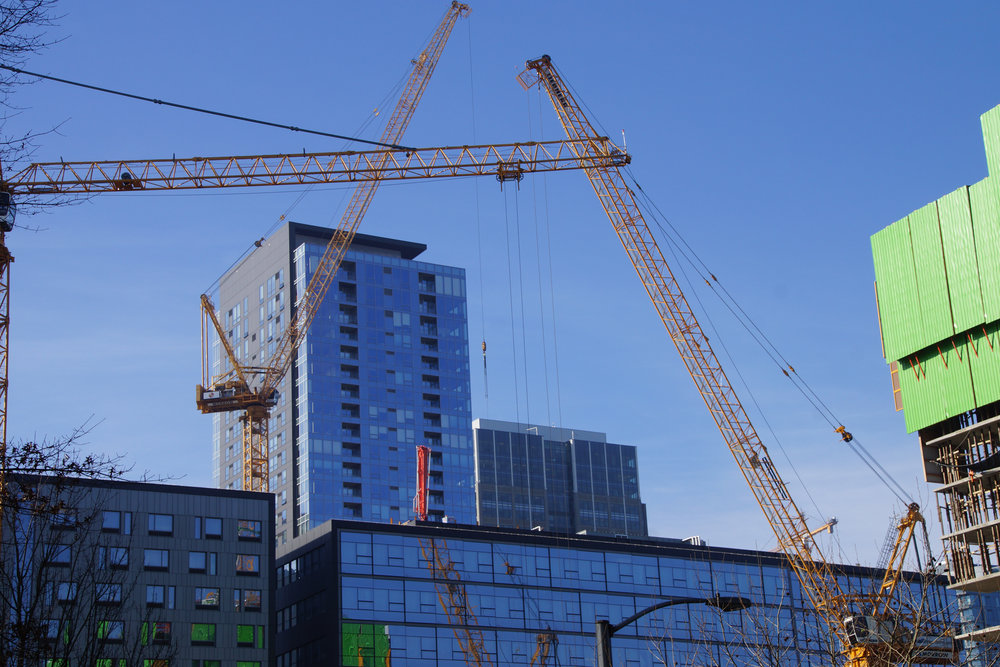 The downtown Seattle skyline reflects a surge of new development, as cranes hearken in new buildings amidst downtown Seattle's high-rises.
