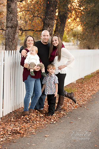 Family photo by picket fence - Redding CA Photographer - Dani D Photography