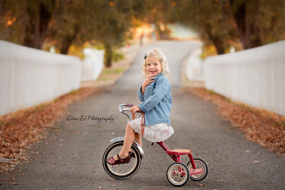 young girl on tricycle - Redding CA photographer - Dani D Photography