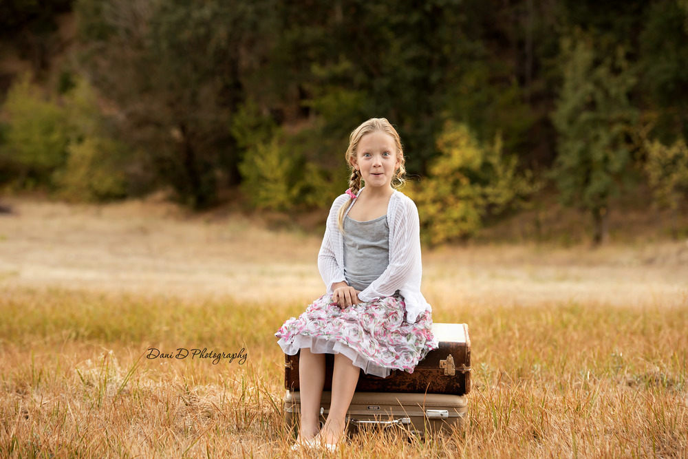 child's portrait in a field - Redding CA photographer - Dani D Photography