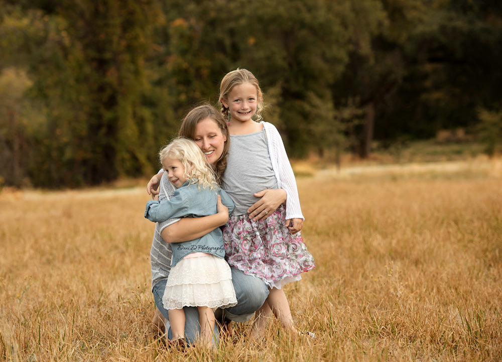 Mom hugging daughters - Redding CA photographer - Dani D Photography
