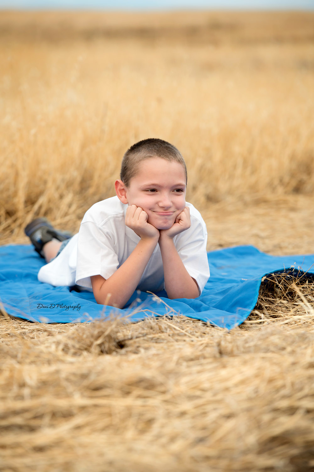 Photo of boy laying on a blanket outside - Redding CA photographer - Dani D Photography