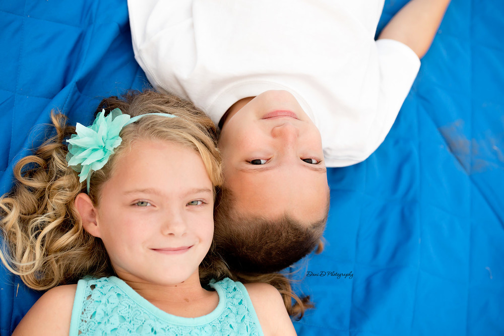 Photo of twins laying on a blanket outside - Redding CA photographer - Dani D Photography