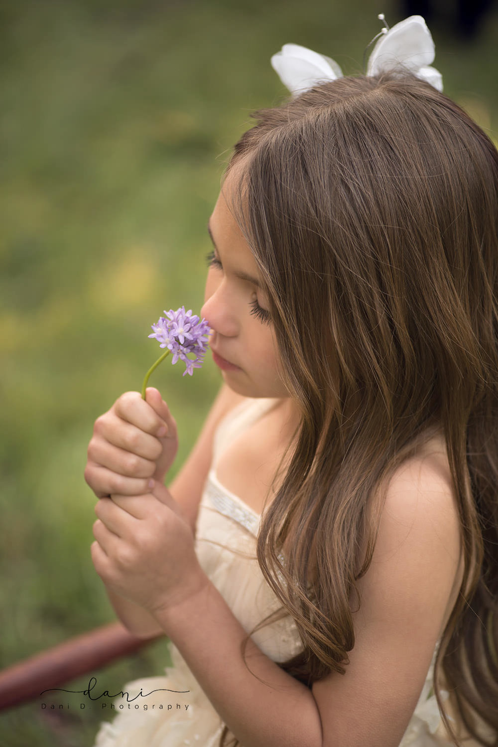 Girl smelling a purple flower - Northern California child and family photographer