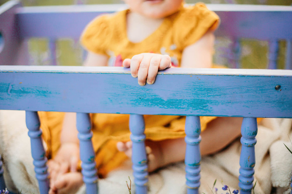 Toddler girl in a blue cradle - Redding CA family photographer