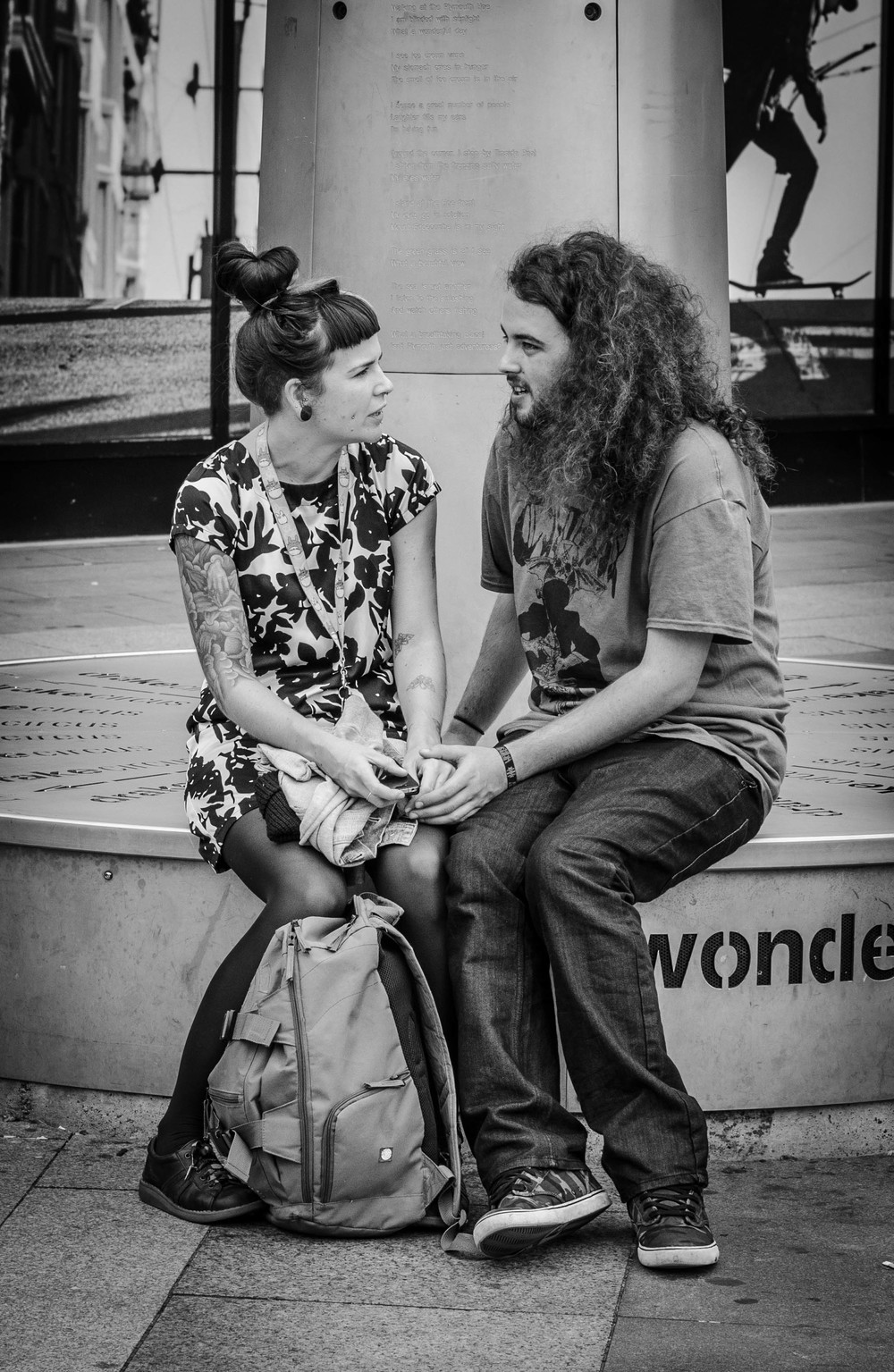 Lovers lost in conversation in Plymouth, UK taken by Bill Thornhill