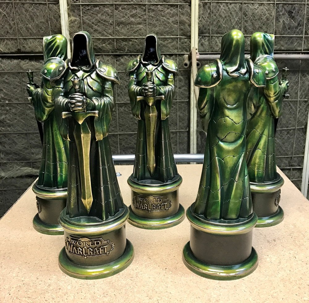 "World of Warcraft champions' awards with a custom ""fel"" green finish."