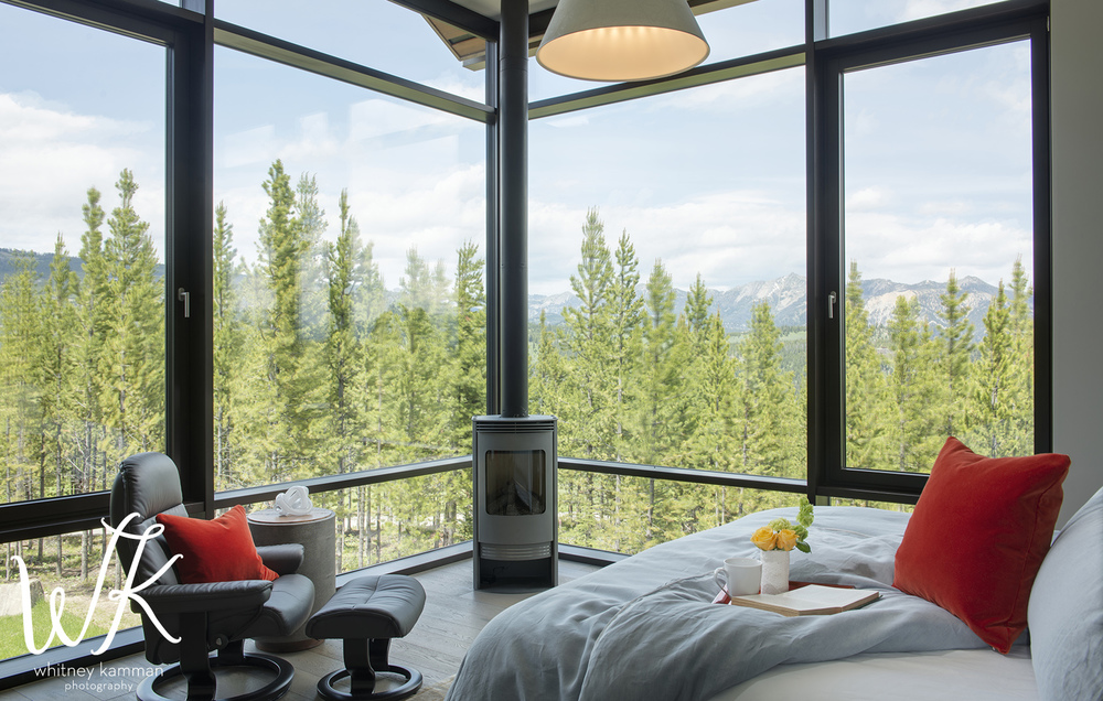 The large windows make me want to stay in this room all day! I can imagine cuddled up watching the sunset or a winter storm blow through.