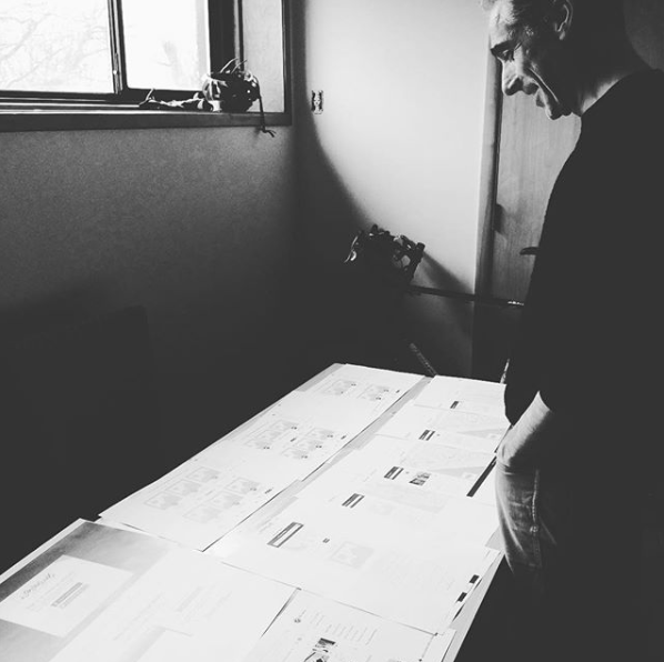 Here's the Chief Product Officer, Andrej Gregov doing a design review for me in our Georgetown office. I printed out the screens so we could really review the overall flow of the main navigation screens of the site.