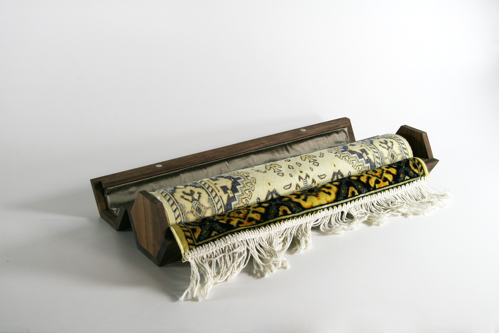 The goal of this project was to package a precious object provided by a classmate. For my object, a prayer rug, I designed a travel and storage case.The walnut case closes magnetically and is lined with silk to highlight the importance of the rug without distracting from it.