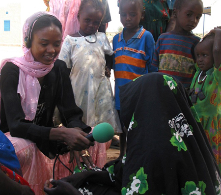 Houda Malloum interviews a woman for her radio show on gender based violence.   (credit:  Jaime Little/ Internews)