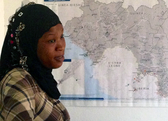 Asmaou Diallo looks at map of the area in West Africa affected by Ebola.   (credit: Internews)