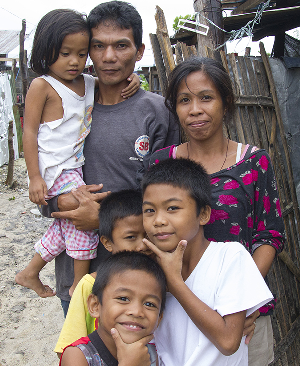 Buboy was able to re-connect with his wife's family after they lost contact due to the typhoon.  (credit: Internews)