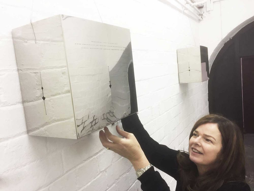 Caro Williams installing  Call and Response  in the Cells, Trowbridge Town Hall   (Photo: Bob Mytton)