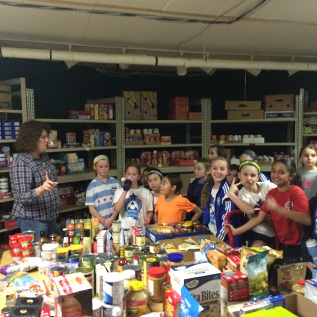 CSA players learning all about the local food pantry!