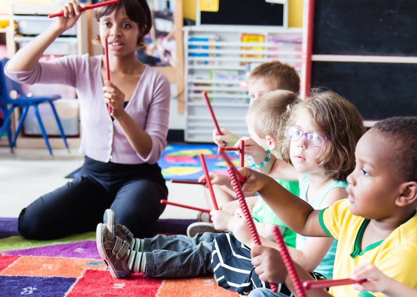 Exploring rhythm instruments - We introduce children to a variety of small percussion instruments to develop steady beat, rhythm, improvisation and self regulation.