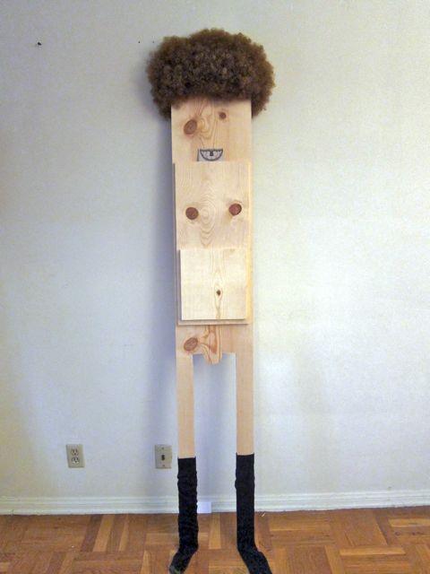 Untitled  2014  Wig, socks, wood  72 x 15 inches