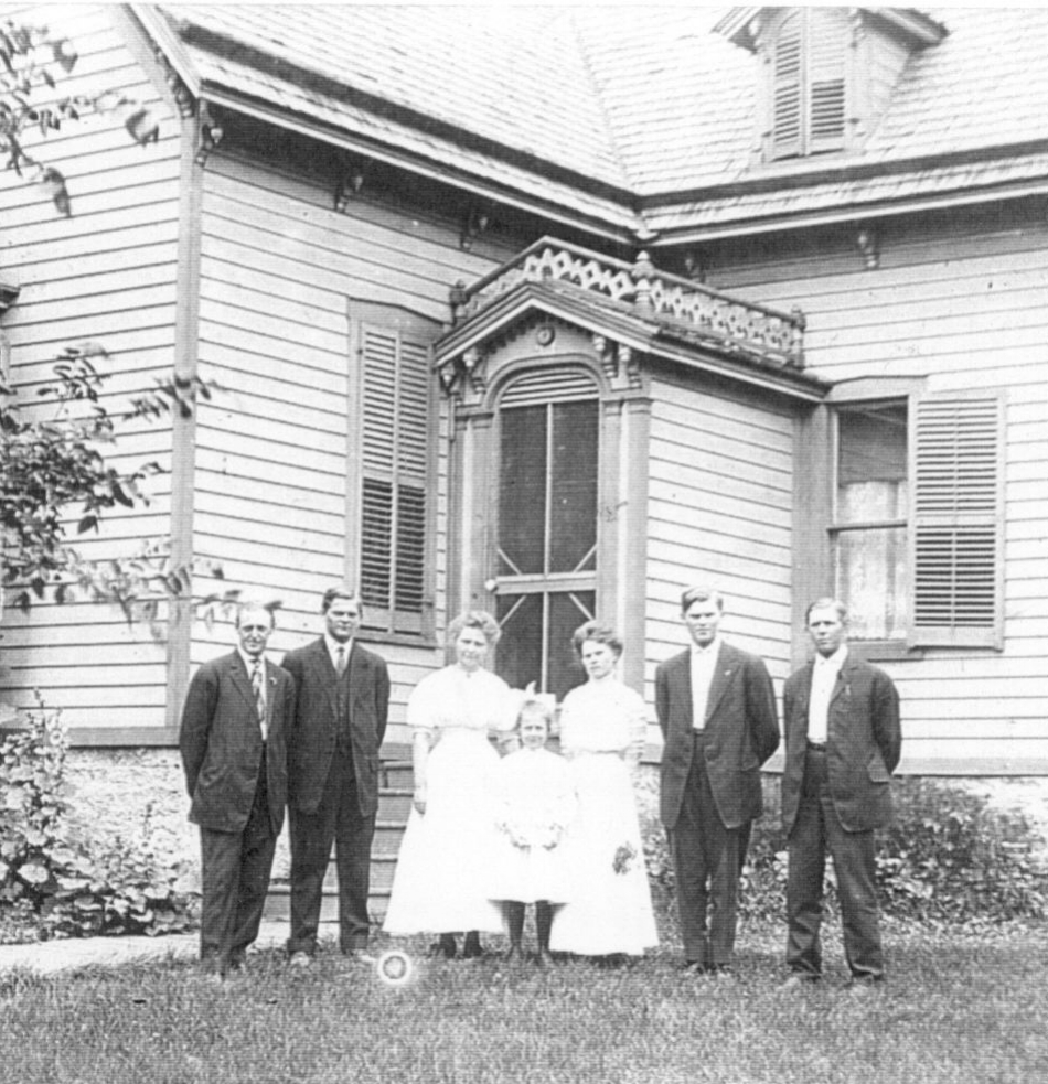 Anderson family in front of their frame house at 91 E. Second Street, (now 304 S. Second Avenue) that Anna Stina bought in 1902. c. 1909.