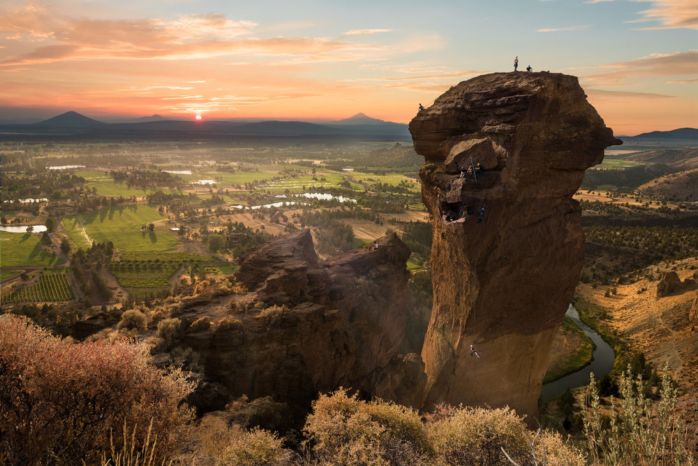 Rock climbers hanging off of Monkey Face like, well, monkeys | Sunset at Monkey Face | Smith Rock State Park | Oregon