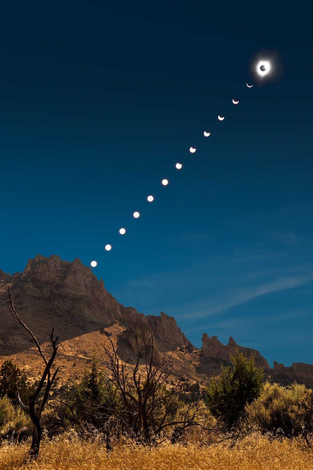 Solar Eclipse Progression | Smith Rock State Park | My wide-angle shot of the phenominon over Smith Rock State Park.  This image is a composite of 27 images - 13 focus stacked images of the foreground, 13 frames of the sun, and an additional image of the sky.