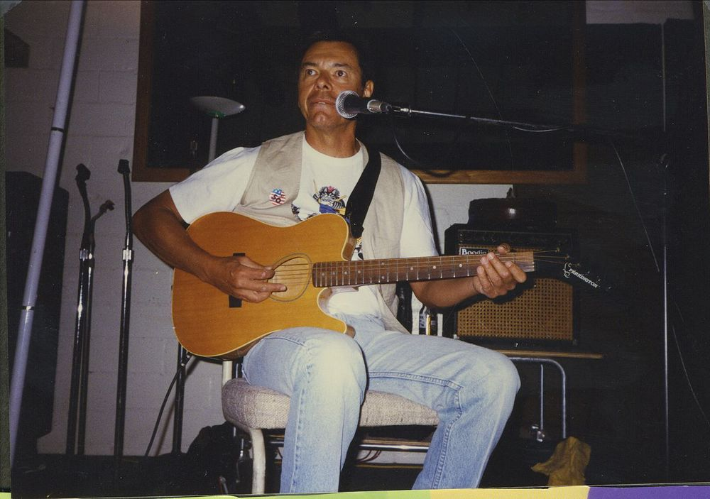 Don Luna performing acoustic guitar
