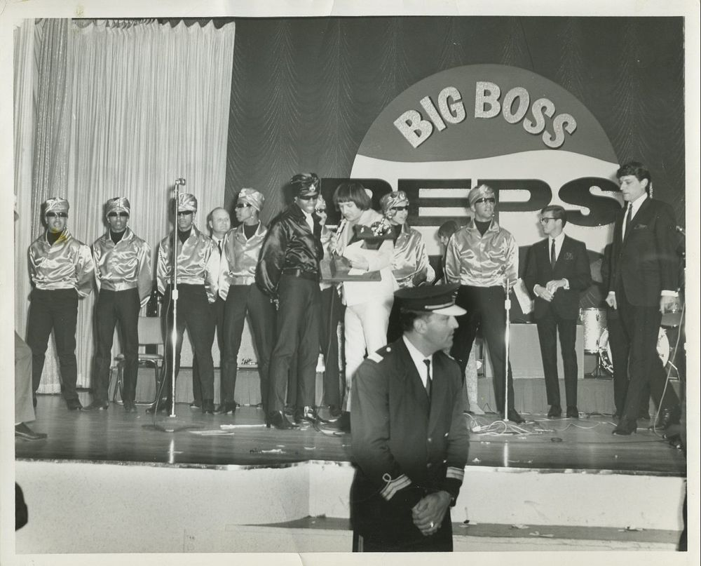 Sonny Bono presents the Teen Turbans with the top prize at the KHJ Pepsi Big Boss Battle of the Bands, 1966. I am directly behind Sonny Bono, to the right.