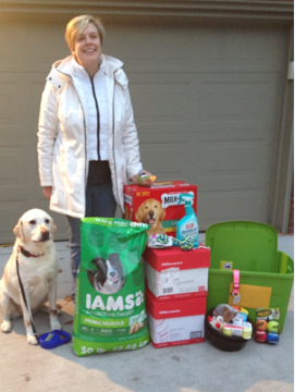Emily &Ryan Graham along with Bella delivering food and supplies to Adopt a Pup