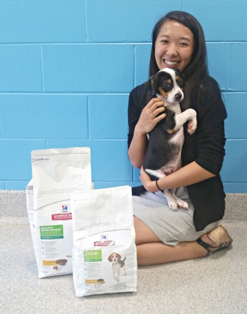 Lily Rau, Quantam Solutions, with Mugsley at Capital Area Humane Society