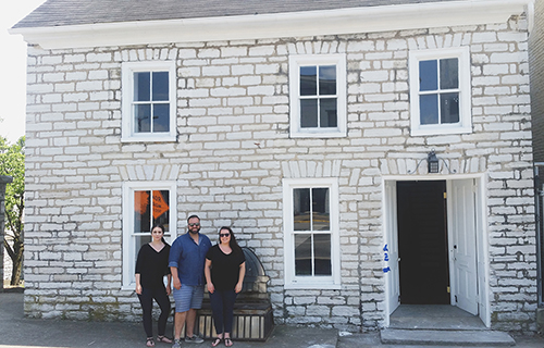 Quantam Solutions' Quantam Cares Team members outside of the recently renovated house-turned office in downtown Frankfort