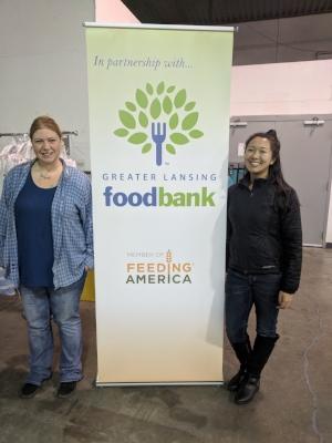 Sarah Szwejda, Greater Lansing Food Bank Volunteer Program Manager, and Lily Rau, Quantam Cares Lead