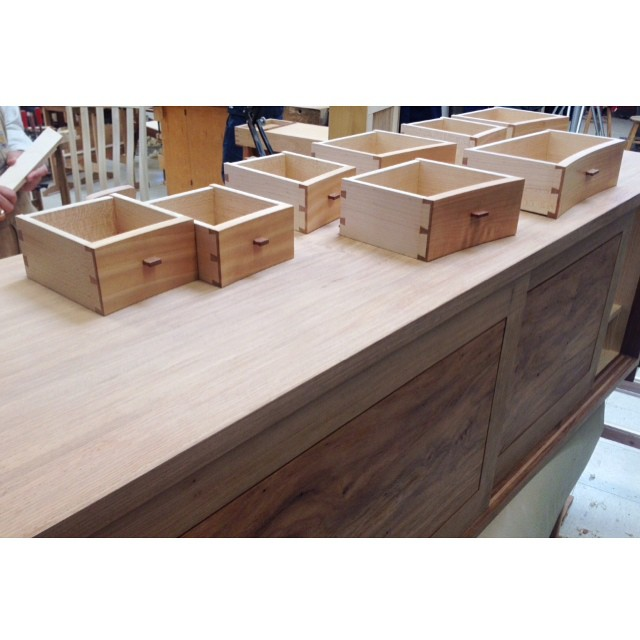 8 of Derrick's 11 curved cypress drawers resting  on Brian's Narra sideboard #handmademindmade #finefurniture #sanfrancisco #slowdownmakemore