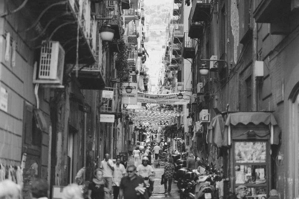 Busy italian Back Street With People and Buildings.jpg