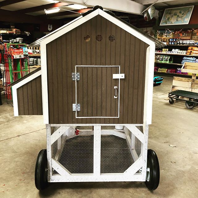 """Thinking about getting chickens this spring? We have everything you need, to include this recently finished chicken tractor. A 2' x 4' x 3' coop with linoleum flooring, three nesting boxes, and roosting pole sits atop a 3' x 6' x 2' painted run that is entirely enclosed and on 16"""" solid core tires. This tractor also has a built in PVC waterer and gravity fed feeder. 3-4 adult chickens can live comfortably and completely safe from predators and rodents. Contact the shop for pricing, delivery is available. We'll see you soon!"""