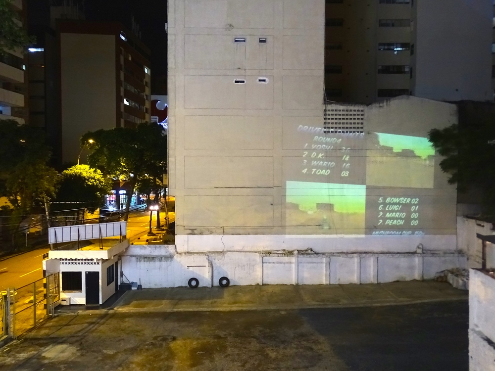 Guys from the hostel were playing video games projected on the wall of the building next door!