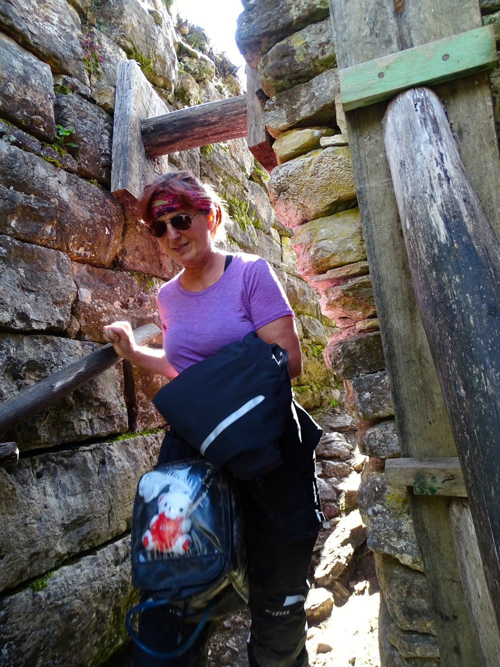 The entrance to the topmost level was much narrower, easy for Jalene but I had to turn my shoulders as I went up. Stone steps were tall, uneven, and somewhat difficult.