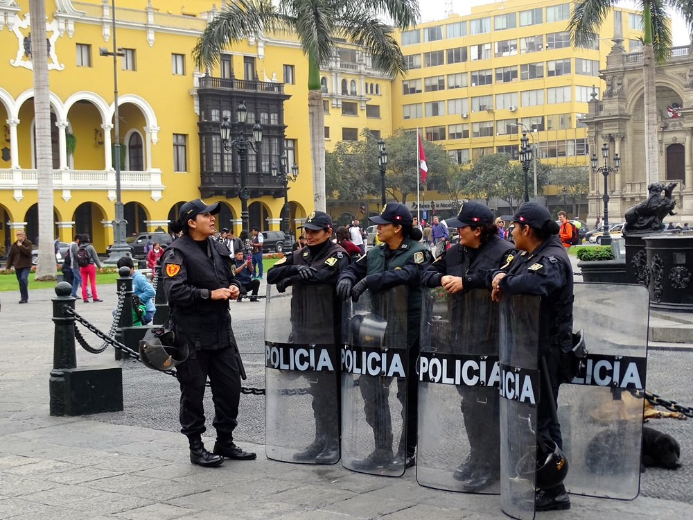 The local policia in the Plaza de Armas.  Not sure why the riot shields today.