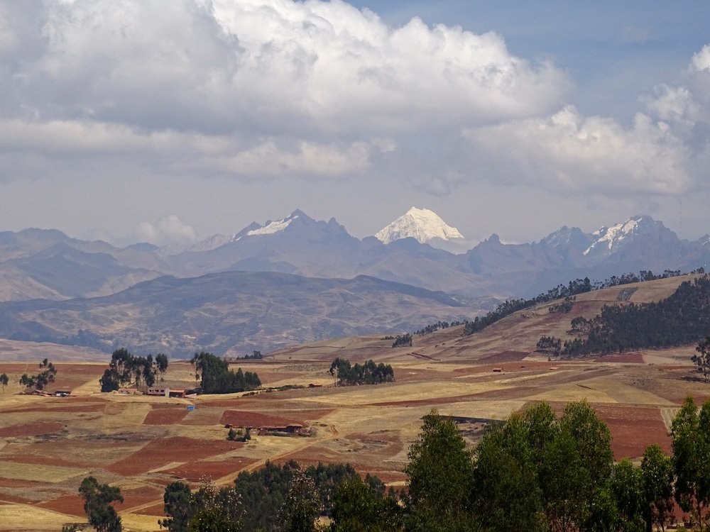 Peruvian peaks to the north of Cusco, rich fields below.