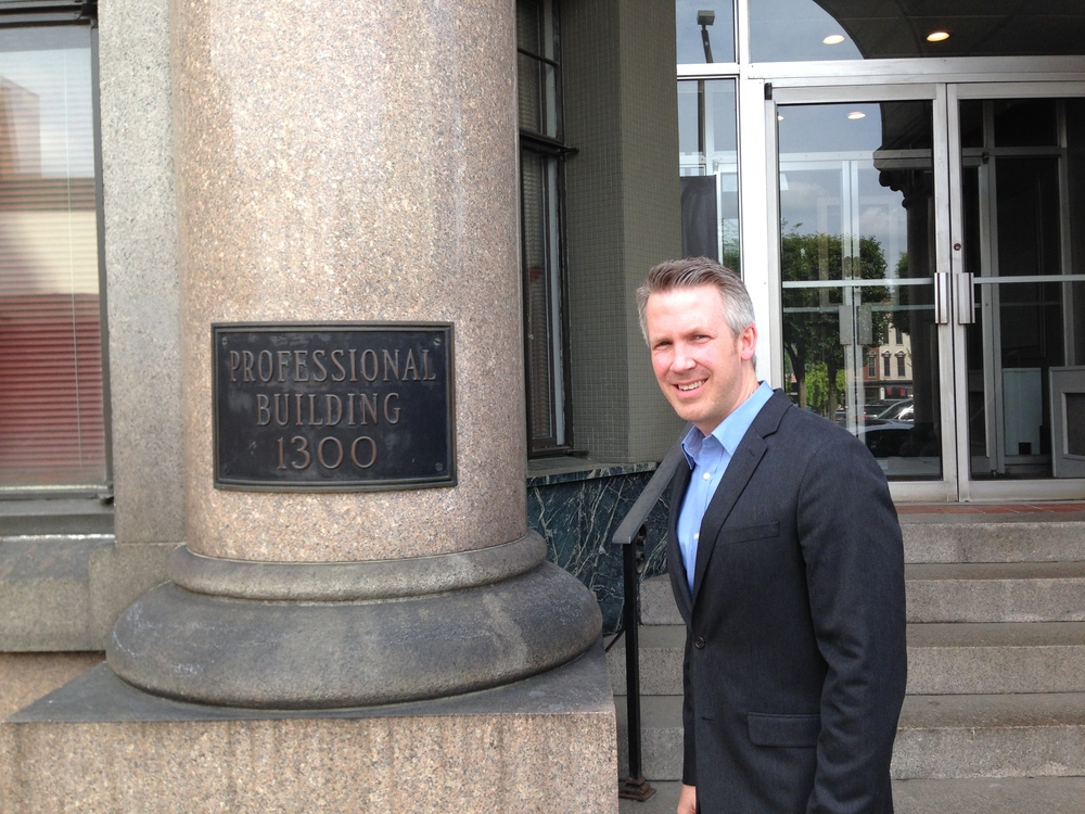 Glenn Elliott, shown here outside the historic Professional Building on Market Street, plans to restore the tower while also calling it home. Elliott is running for mayor of Wheeling in next year's election.