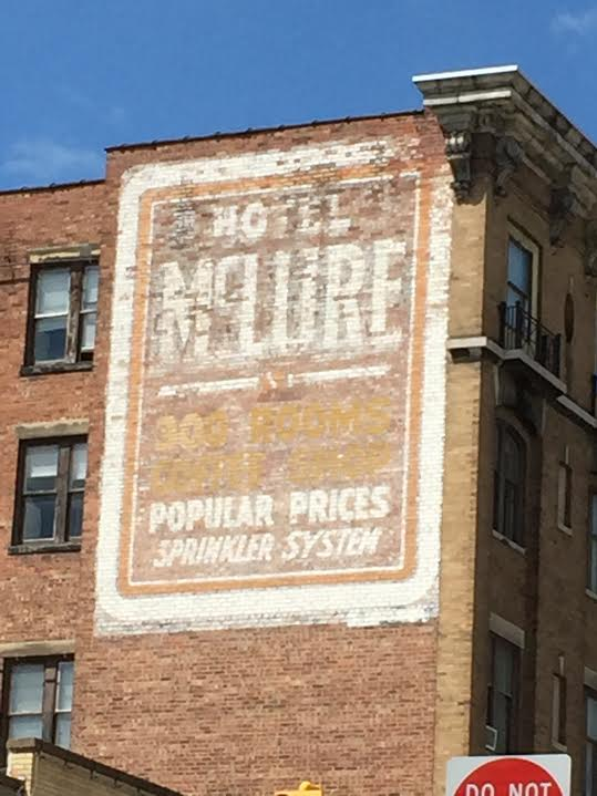 "The Hotel McClure ghost sign downtown proudly boasts ""300 rooms, popular prices [and a] sprinkler system."""