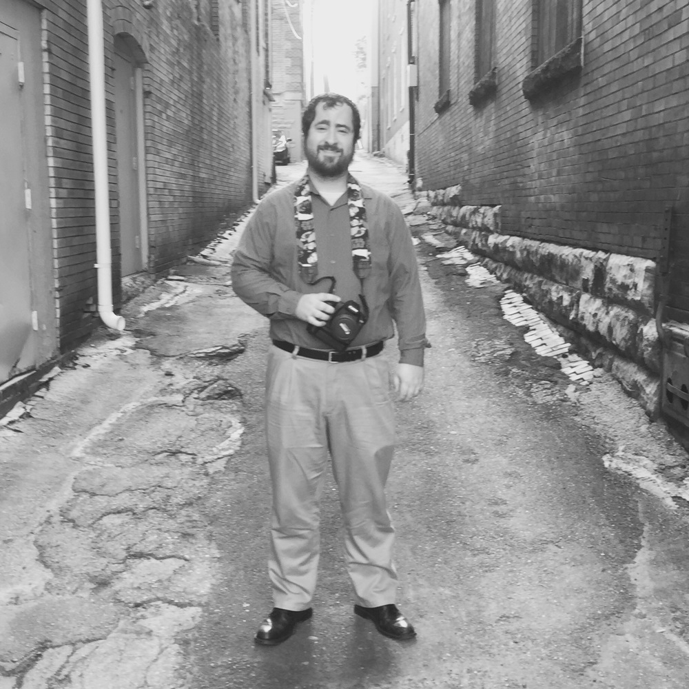 Bennett McKinley poses in the alley he's made famous with his Meet Me in the Alley series. Photo by Lee Chottiner;all other photos pictured here are by McKinley.