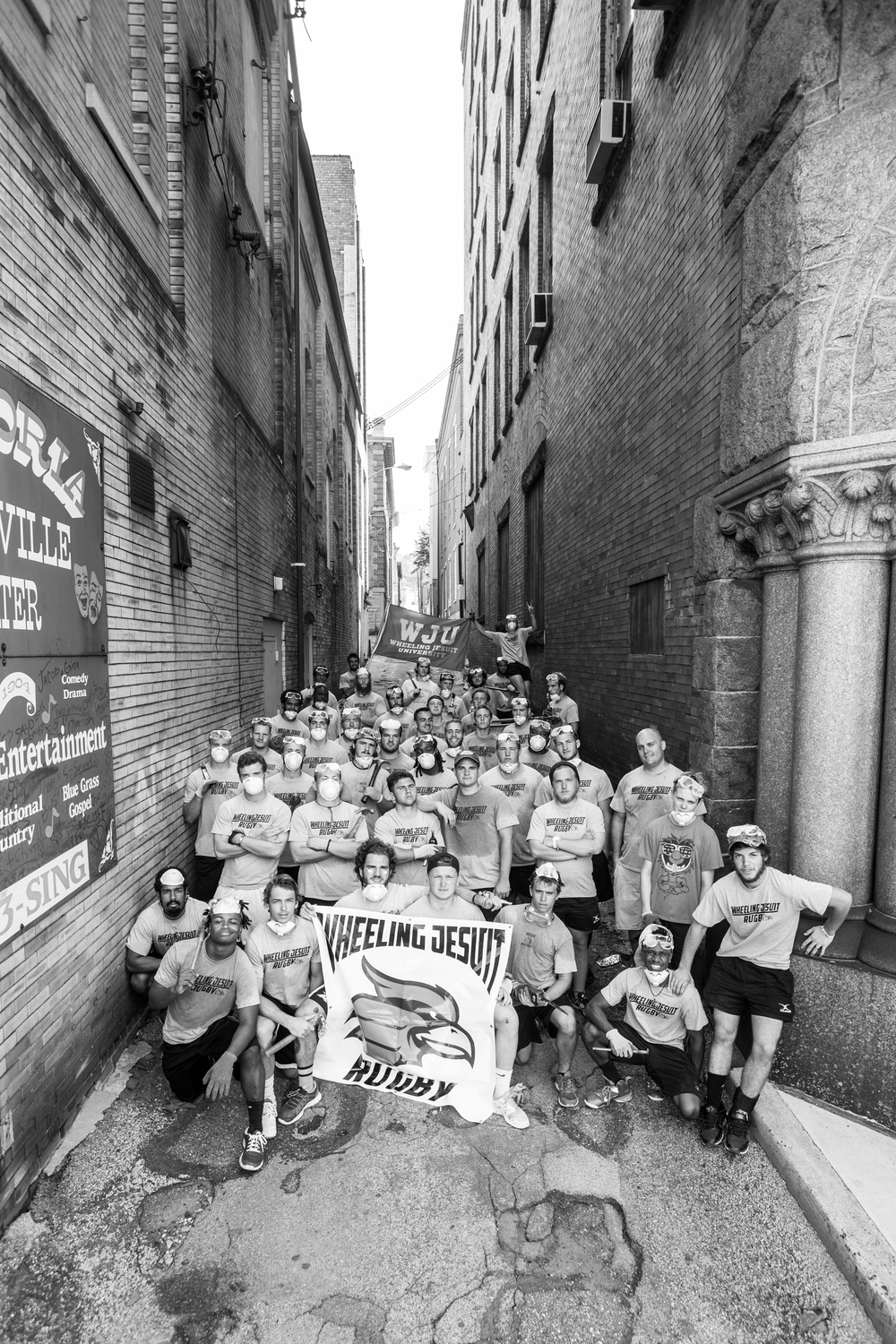 The Wheeling Jesuit rugby team barely fit into the narrow alley.