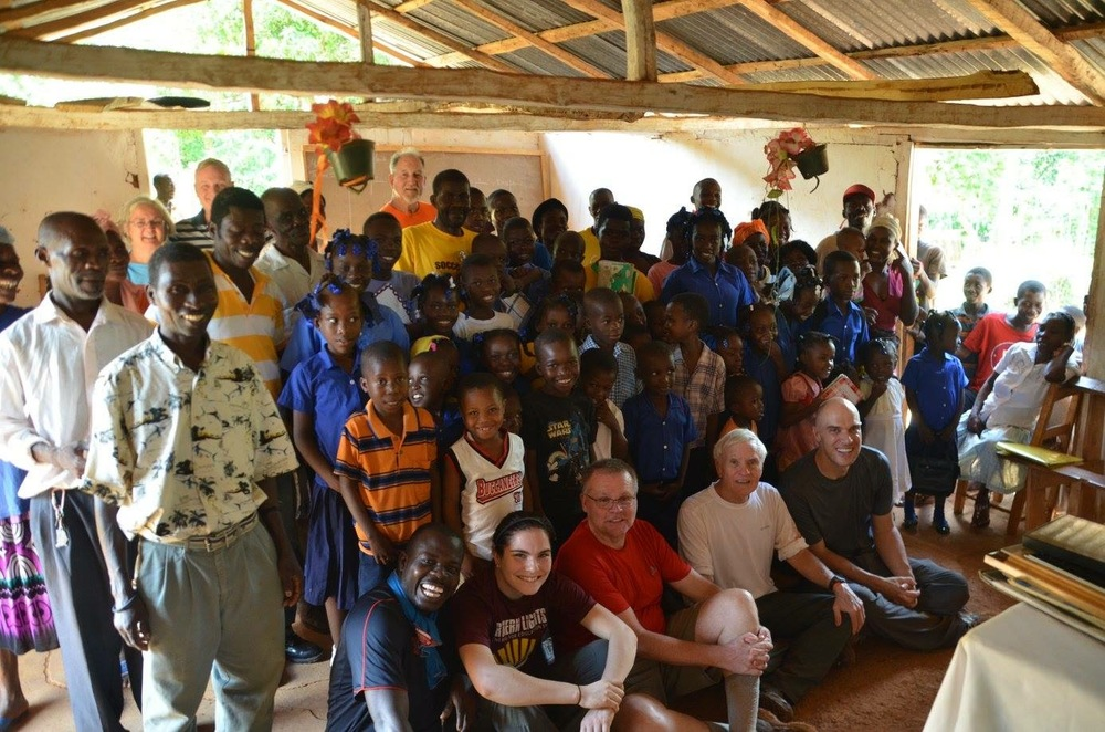 C3 members with Haitian school children in the village of Gelin. (Photo courtesy of Adam MIck)